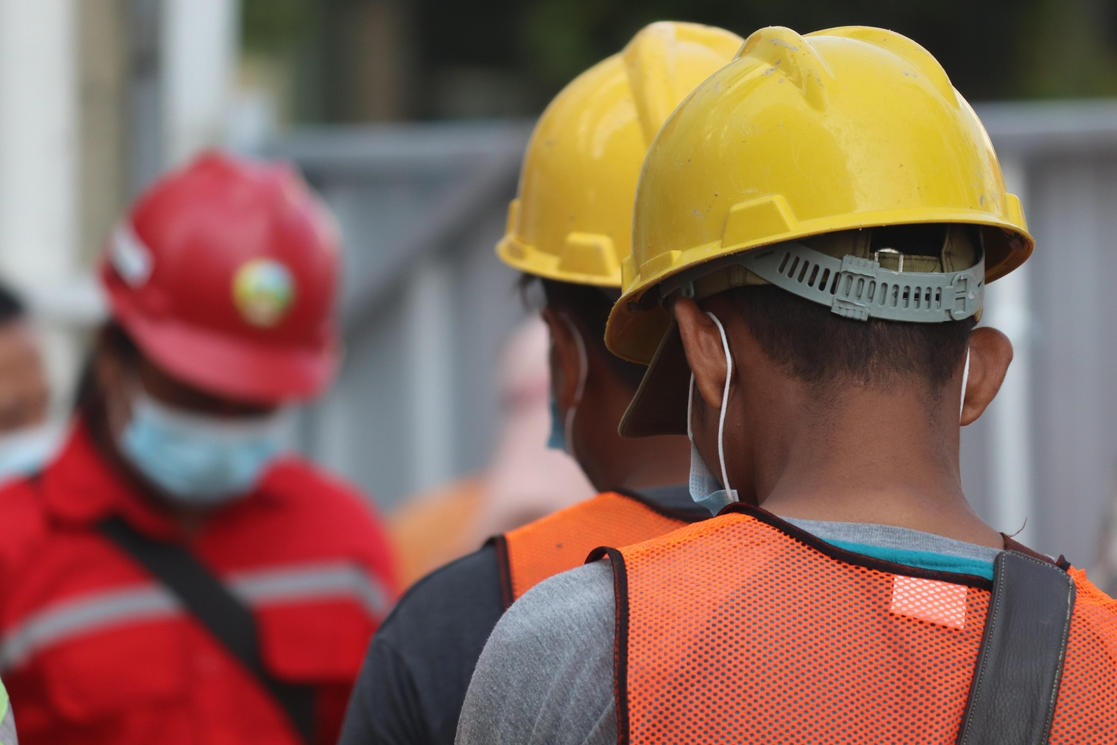 Construction workers wearing yellow safety hats